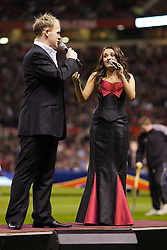 Manchester, England - Tuesday, March 13, 2007: Opera singers xxxx and xxxx perform 'Barcelona' before the UEFA Celebration Match between Manchester United and a Europe XI at Old Trafford. (Pic by David Rawcliffe/Propaganda)