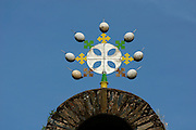 GONDAR, GONDAR/ETHIOPIA..Debre Birhan Selassie Church with gable cross adorned with traditional 7 ostrich eggs..(Photo by Heimo Aga)