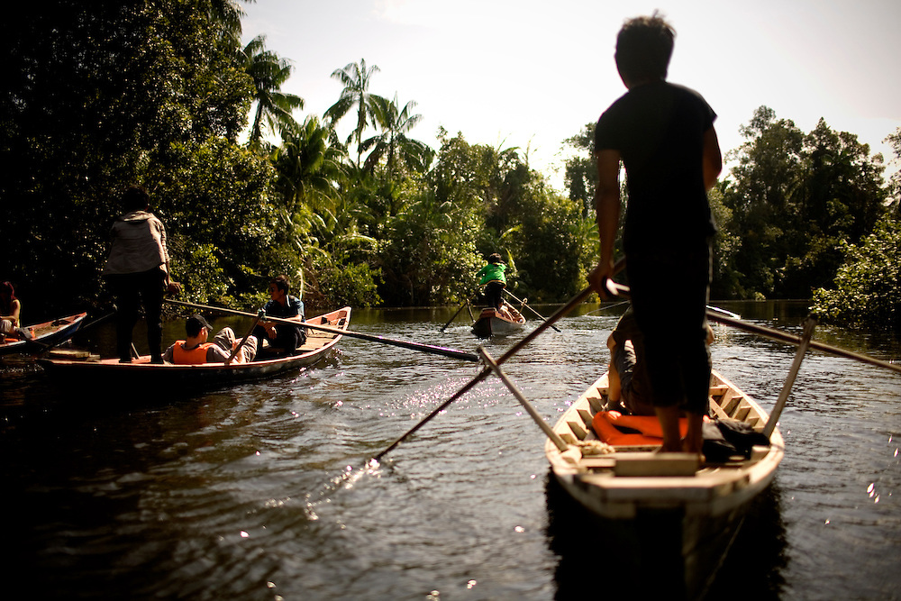 French tourists take a boat ride from the community-based ecotourism village of Chi Phat, on the Preak Piphot River, to Steung Prah river, in the Southern Cardomoms Protected Forests in the Koh Kong Province, Cambodia, on Thursday, Dec. 2, 2010. The Chi Phat Ecotourism Village center helps arrange treks while seeing daily village life.