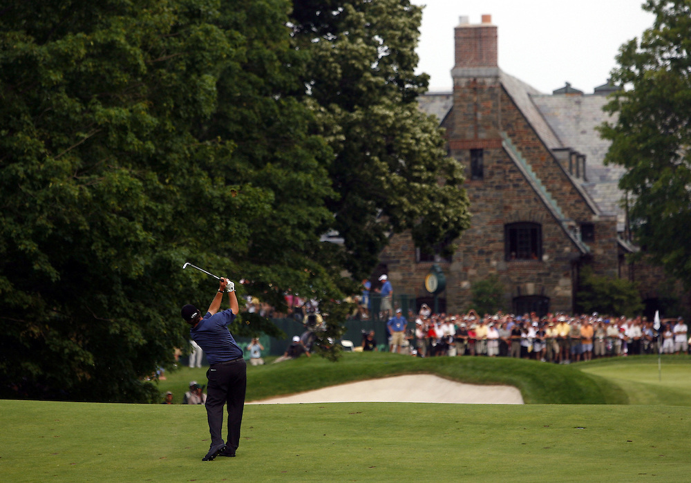 Phil Mickelson of the US hits his approach shot towards the eighteenth green during the third day of the US Open Golf Championship at Winged Foot Golf Club in Mamaroneck, New York Saturday, 17 June 2006. .