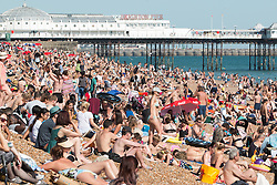 © Licensed to London News Pictures. 19/07/2016. Brighton, UK. Thousands of people relax and sunbathe on the beach in Brighton on the hottest day of the year as temperatures hitting 28C on the South Coast. Photo credit: Hugo Michiels/LNP