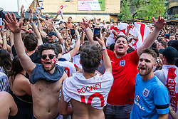 © Licensed to London News Pictures. 07/07/2018. London, UK. England fans celebrate in Flat Iron Square, London, as the final whistle goes in the World Cup Quarter Final game between England and Sweden. England won the game 2-0. Photo credit: Rob Pinney/LNP