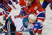 KELOWNA, CANADA - FEBRUARY 17:  Carsen Twarynski #18 of the Kelowna Rockets and Jeff Faith #4 of the Spokane Chiefs at the Kelowna Rockets game on February 17, 2017 at Prospera Place in Kelowna, British Columbia, Canada.  (Photo By Cindy Rogers/Nyasa Photography,  *** Local Caption ***