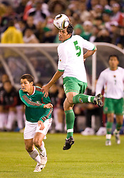 February 24, 2010; San Francisco, CA, USA;  Bolivia defender Santos Amador (5) heads the ball against Mexico during the first half at Candlestick Park. Mexico defeated Bolivia 5-0.