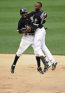 CHICAGO - JULY 09:  Juan Pierre #1 (L) and Alexei Ramirez #10 of the Chicago White Sox celebrate after Ramirez drove in the game winning run in the bottom of the nigninthhth inning against the Minnesota Twins on July 9, 2011 at U.S. Cellular Field in Chicago, Illinois.  The White Sox defeated the Twins 4-3.  (Photo by Ron Vesely)  Subject: Juan Pierre;Alexei Ramirez.