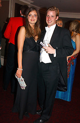 LADY NATASHA RUFUS-ISAACS and ANTHONY BELL at  the Royal Caledonian Ball held at The Grosvenor House Hotel, Park Lane, London on 5th May 2006.<br />