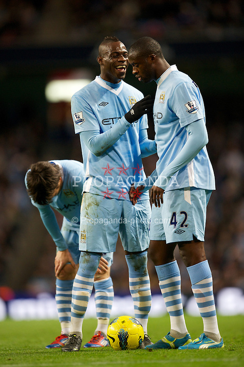 MANCHESTER, ENGLAND - Saturday, February 25, 2012: Manchester City's Mario Balotelli jokes with Yaya Toure against Blackburn Rovers during the Premiership match at City of Manchester Stadium. (Pic by David Rawcliffe/Propaganda)