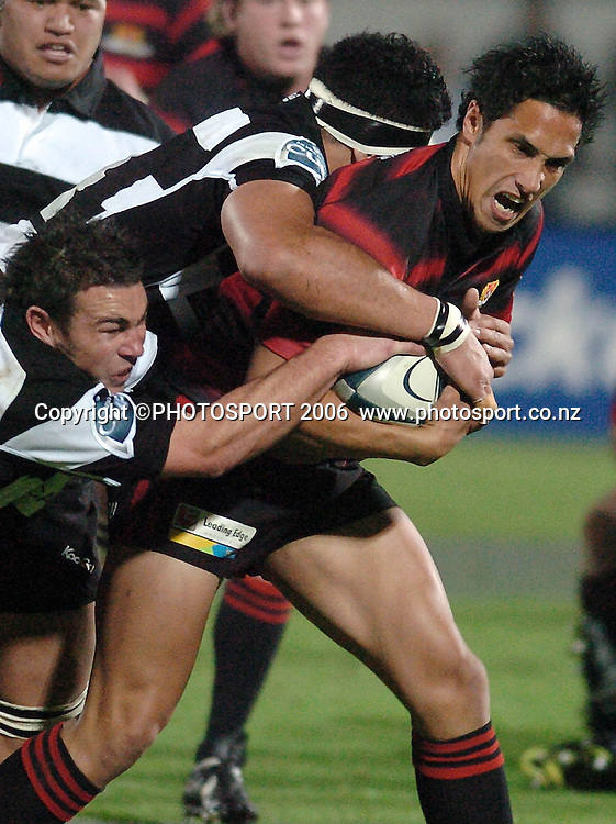 Canterburys Stephen Brett is wrapped up by the Hawkes Bay defence during the Air New Zealand Cup week 1 rugby match between Hawke's Bay and Canterbury at Mclean Park, Napier on Friday 28 July 2006. Photo: John Cowpland/PHOTOSPORT<br /> <br /> <br /> <br /> <br /> <br /> 280706
