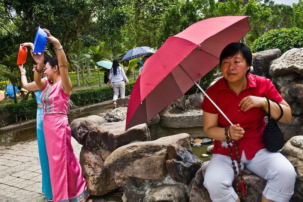 Han Chinese tourist visit Dai Park in Yunnan, China. China's 1.3 billion people are officially 96 percent Han; the rest range from Tibetans to Naxi to Manchus, categories fixed after the 1949 Communist revolution. The companies running the parks are generally Han-owned, say industry workers.