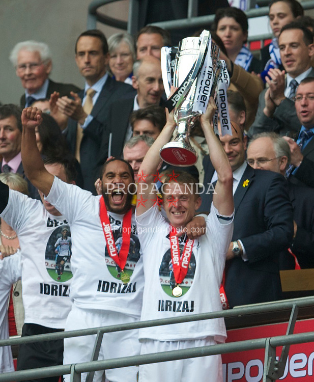 LONDON, ENGLAND - Saturday, May 30, 2011: Swansea City's Garry Monk lifts the trophy with Ashley Williams after his side beat Reading 4-2 after the Football League Championship Play-Off Final match at Wembley Stadium. (Photo by David Rawcliffe/Propaganda)