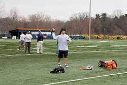 Chris Long, expected to be near the top of the first round of the 2008 NFL draft throws a football to his coach Al Groh.  Scouts from various NFL teams were present to evaluate prospective players at the 2008 Virginia Football Pro Day held at the UVA Football training facilities at the McCue Center on the Grounds of the University of Virginia in Charlottesville, VA on March 18, 2008.