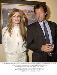 JEMIMA KHAN daughter of the late Sir James Goldsmith and her husband MR IMRAN KHAN, at an exhibition in London on 22nd May 2001.OOL 13 2oro