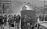 British soldiers use a water canon against rioters on the Lower Falls Road area of Belfast. The rioting broke out following a People's Democracy march was prevented by soldiers and police from entering the city centre in Belfast, N Ireland. The march was in support of PD leaders Michael Farrell and Tony Canavan who were on hunger strike seeking political status in Belfast's Crumlin Road Jail.  29 July 1973, 197307290522e<br />