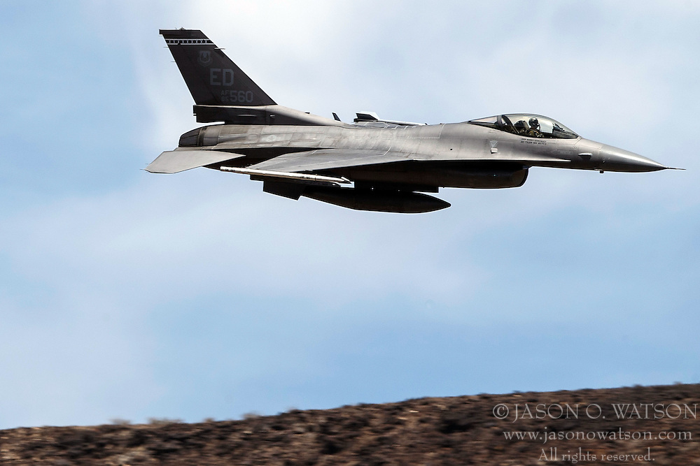 US Air Force General Dynamics F-16C Fighting Falcon (SN 85-1560) from the 412th Test Wing, Edwards Air Force Base, flies through the Jedi Transition, R-2508 complex, Star Wars Canyon / Rainbow Canyon, Death Valley National Park, California, United States of America.