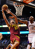 Nov. 09, 2012; Phoenix, AZ, USA; Cleveland Cavaliers center Anderson Varejao (17) lays up the ball against the Phoenix Suns forward P.J Tucker (17) during the first half at US Airways Center. Mandatory Credit: Jennifer Stewart-US PRESSWIRE.