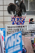 A vulture hanging over the NHS - NHS In Crisis - Fix It Now March and Demonstration - organised by the Peoples Assembly started in Gower Street and finished outside Downing street.