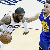 08 June 2016: Cleveland Cavaliers guard Kyrie Irving (2) drives past Golden State Warriors guard Stephen Curry (30) during the Cleveland Cavaliers 120-90 victory over the Golden State Warriors, during Game Three of the 2016 NBA Finals at the Quicken Loans Arena, Cleveland, Ohio, USA.
