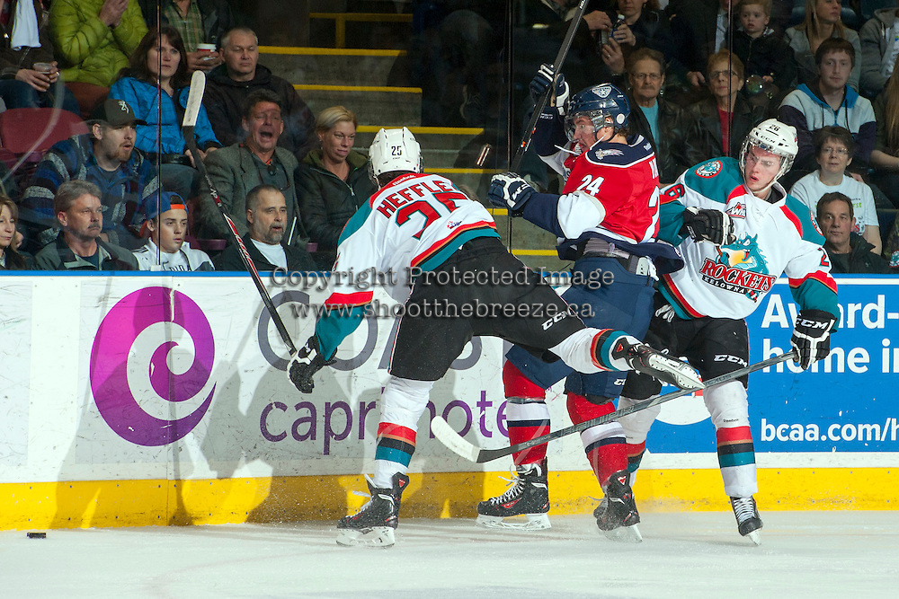 KELOWNA, CANADA - MARCH 22: Colton Heffley #25 of the Kelowna Rockets checks Jackson Playfair #24 of the Tri-City Americans at the boards on March 22, 2014 at Prospera Place in Kelowna, British Columbia, Canada.   (Photo by Marissa Baecker/Shoot the Breeze)  *** Local Caption *** Colton Heffley; Jackson Playfair;