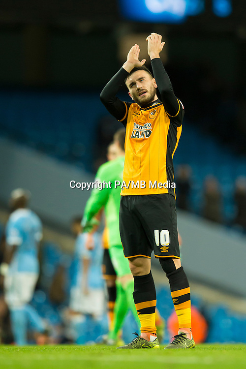 Hull City's Robert Snodgrass applauds supporters after his team's English League Cup soccer match between Manchester City and Hull City at the Etihad Stadium, Manchester, England, Tuesday, Dec. 1, 2015. (AP Photo/Jon Super)