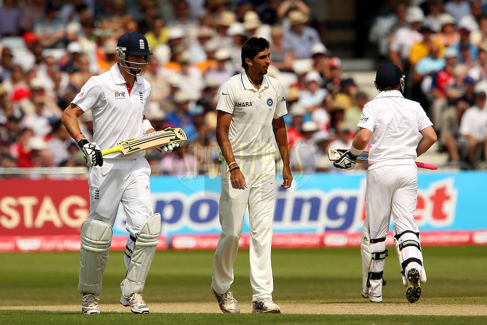 Ishant Sharma walks back as Kevin Pietersen and Ian Bell make the run during day 3 of the 2nd test between England and India held at Trent Bridge Cricket Ground in Nottingham on the 31st July 2011...Photo by Ron Gaunt/SPORTZPICS/BCCI