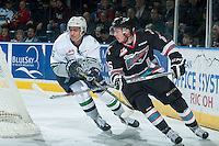 KELOWNA, CANADA - NOVEMBER 26: Jarret Tyszka #5 of Seattle Thunderbirds checks Cole Linaker #26 of Kelowna Rockets on November 26, 2015 at Prospera Place in Kelowna, British Columbia, Canada.  (Photo by Marissa Baecker/Shoot the Breeze  *** Local Caption *** Jarret Tyszka; Cole Linaker;