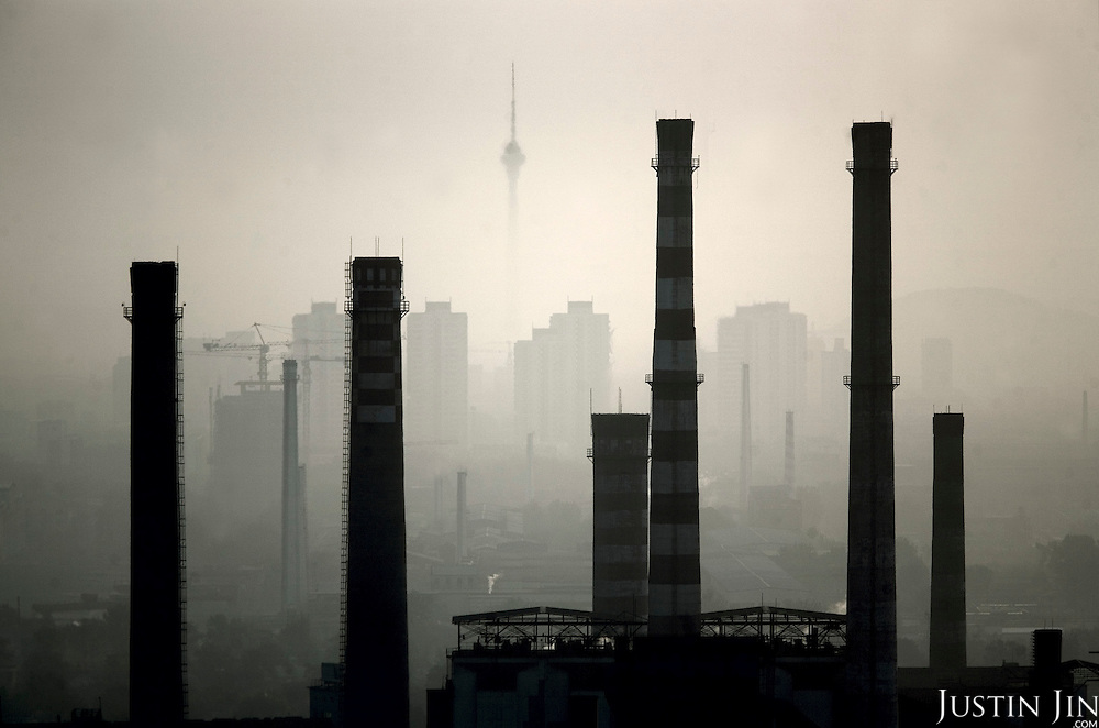 Smog shrouds Shougang factory in Beijing, which is getting ready to host the 2008 Olympics. The CCTV tower is in the back. Beijing is one of the most air-polluted cities on earth.
