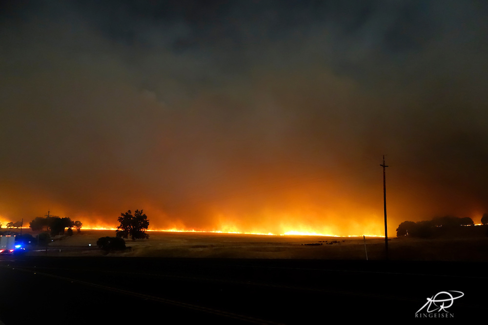 September 12, 2015 - Lake County, California,  Fast moving Valley Fire races across the pasture at Hidden Valley. (Kim Ringeisen / Polaris)