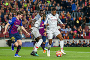 Liverpool striker Sadio Mane (10) holds off Barcelona defender Sergi Roberto (20) as Liverpool midfielder Georginio Wijnaldum (5) goes past during the Champions League semi-final leg 1 of 2 match between Barcelona and Liverpool at Camp Nou, Barcelona, Spain on 1 May 2019.