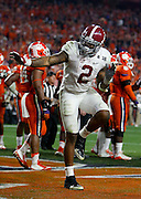 Derrick Henry strikes the Heisman pose after scoring the touchdown to seal Alabama's 45-40 victory over Clemson in the College Football National Championship game in the University of Phoenix Stadium Monday, January 11, 2016.  Staff Photo | Gary Cosby Jr.