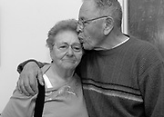 Fabiola Trejo gets a kiss from husband Robert while visiting him at his care facility in Hayward, Calif. Jan. 17, 2007. Robert was diagnosed with Alzheimer's disease in 2002, and Fabiola cared for her husband of over 60 years alone in their home for over four years before he suffered a fall and had to be admitted to the care facility.