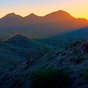 Beams of light at sunset over the San Tan Mountains - Queen <br /> Creek, AZ