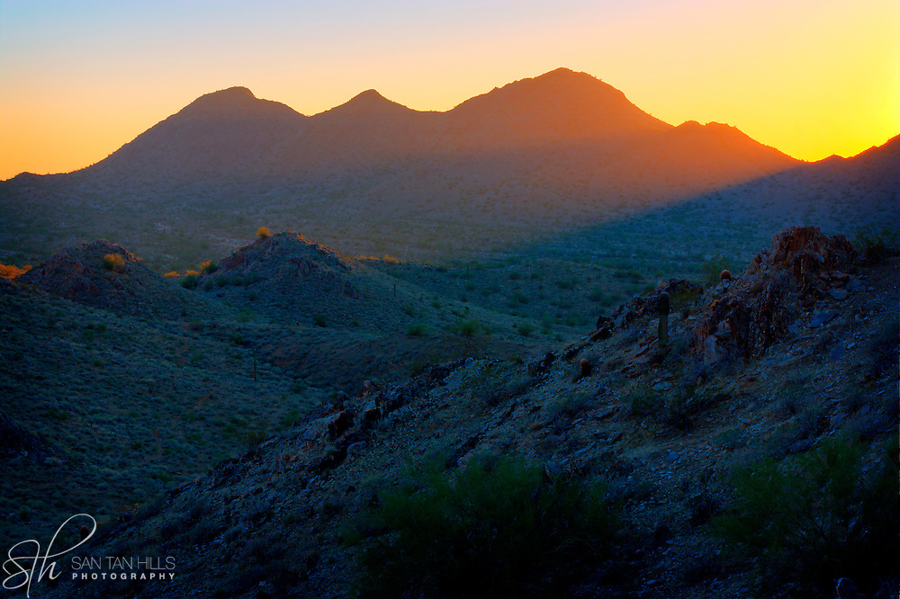 Beams of light at sunset over the San Tan Mountains - Queen <br /> Creek, AZ
