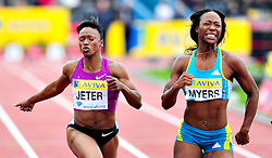 USA's Marshevet Myers (R) and Carmelita Jeter (L) cross the finish line of the women's 100m final, during the Diamond League athletics meeting at Crystal Palace in London on August 14, 2010.