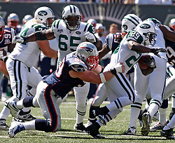 Sept 20, 2009; East Rutherford, NJ, USA;  New York Jets running back Leon Washington (29) is brought down by New England Patriots defensive end Mike Wright (99) during the first half at Giants Stadium.