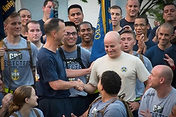 WASHINGTON (Aug. 29, 2018) Chief of Naval Operations Adm. John Richardson, left, congratulates Master Chief Petty Officer of the Navy (MCPON) Russell Smith after announcing his selection as the 15th MCPON. Following a comprehensive review of potential candidates, Smith will serve as the senior-ranking enlisted leader and advisor to the CNO. (U.S Navy photo by Mass Communication Specialist 2nd Class Sarah Villegas/Released) 180829-N-YG104-0245