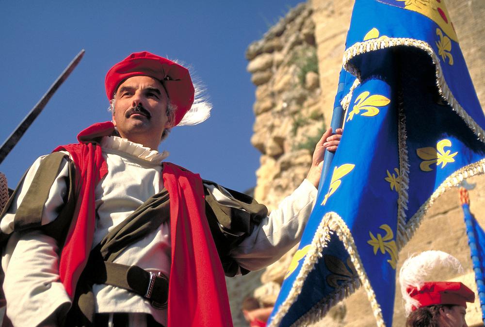 Man with flag at Renaissance Fair  Salon de Provence, France