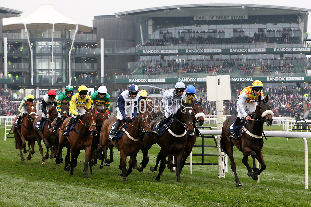 The field heads out on the first circuit with winner Santini and Nico De Boinville (third from right)  for the The Doom Bar Sefton Novices Hurdle Race on Ladies Day at Aintree, Liverpool, United Kingdom on 13 April 2018. at Aintree, Liverpool, United Kingdom on 13 April 2018. Picture by Craig Galloway.