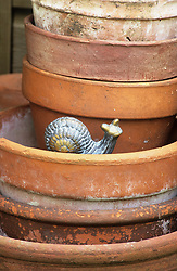 Terracotta pots and snail ornament