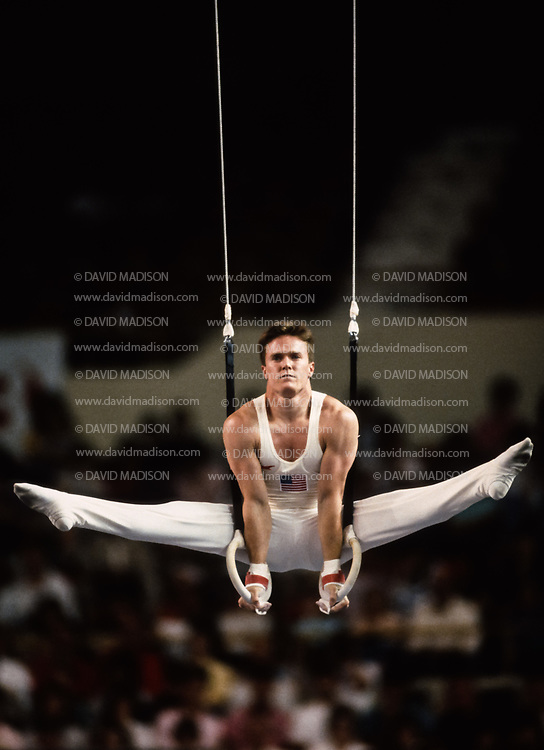 PHOENIX - APRIL 24:  Kevin Davis of the United States competes on the still rings during a USA - USSR gymnastics meet on April 24, 1988  at the Arizona Veterans Memorial Coliseum in Phoenix, Arizona.  (Photo by David Madison/Getty Images)