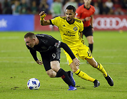 November 1, 2018 - Washington, DC, USA - Columbus Crew SC midfielder Artur (8) defends D.C. United forward Wayne Rooney (9) during the first half of the MLS Cup knockout round playoff match at Audi Field in Washington, D.C., on Thursday, Nov. 1, 2018. (Credit Image: © Adam Cairns/Columbus Dispatch/TNS via ZUMA Wire)