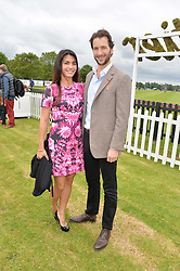 The HON.WILLIAM ASTOR and his wife LOHRALEE at the Cartier Queen's Cup Final polo held at Guards Polo Club, Smith's Lawn, Windsor Great Park, Egham, Surrey on 15th June 2014.
