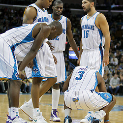 Oct 30, 2009; New Orleans, LA, USA; New Orleans Hornets teammates gather around guard Chris Paul (3) after a collision on the court against the Sacramento Kings at the New Orleans Arena. The Hornets defeated the Kings 97-92. Mandatory Credit: Derick E. Hingle-US PRESSWIRE