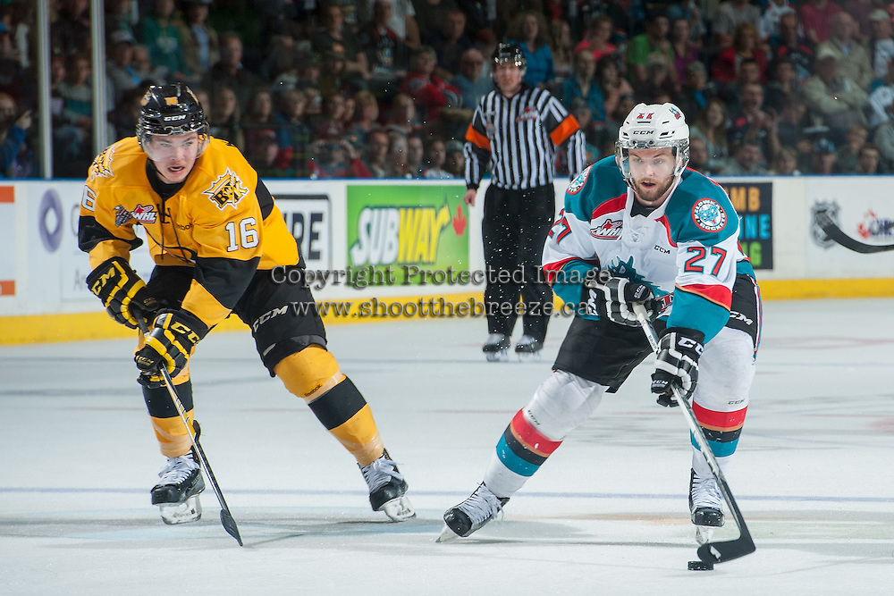 KELOWNA, CANADA - MAY 13: Tanner Kaspick #16 of Brandon Wheat Kings checks Josh Morrissey #27 of Kelowna Rockets as he skates with the puck toward the net during second period on May 13, 2015 during game 4 of the WHL final series at Prospera Place in Kelowna, British Columbia, Canada.  (Photo by Marissa Baecker/Shoot the Breeze)  *** Local Caption *** Tanner Kaspick; Josh Morrissey;