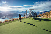 Helicopter Golf: A Par 3 in the Sky Overlooking Queenstown<br /><br />Nestled 4,500 feet up in the breathtaking southern Alps of New Zealand is an unforgettable par 3 golf experience overlooking Queenstown. Accessible only by helicopter, the hole features four different tee boxes located at varying distances and heights from the green.<br />The Over the Top Golf experience is operated by the Over The Top helicopter company in association with the Golf Warehouse. 100% biodegradable, eco golf balls made from wood are recommended. These balls will float in water and can be reused, or will naturally degrade in 3-6 months.<br />Specific site plans and resource consents took over a year to complete with helicopters ferrying earth moving equipment, men, sand and turf across Lake Wakatipu. Ecologists and conservation people were also flown to ensure that the pristine environment remained intact.<br />the cost is $475 NZD per person.<br />©Over the top/Exclusivepix Media
