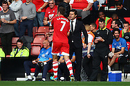Picture by Paul Terry/Focus Images Ltd +44 7545 642257<br /> 28/09/2013<br /> Rickie Lambert ( L ) of Southampton celebrates with manager Mauricio Pochettino, after scoring to make it 2-0 during the Barclays Premier League match at the St Mary's Stadium, Southampton.