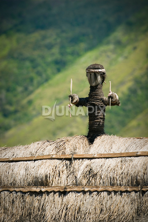 Detail of effigy decorating a roof at Bena village, Flores