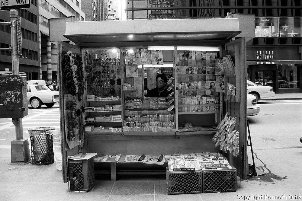 A newspaper stand that no longer exists on the corner of 59th Street and Madison Avenue.