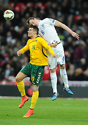 Phil Jones of England (Manchester United) battles for the high ball with Simonas Stankevicius of Lithuania  - Photo mandatory by-line: Joe Meredith/JMP - Mobile: 07966 386802 - 27/03/2015 - SPORT - Football - London - Wembley Stadium - England v Lithuania - UEFA EURO 2016 Qualifier