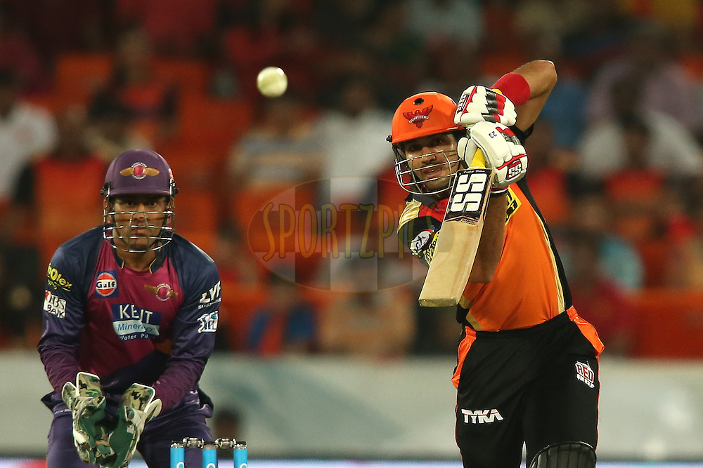Naman Ojha of Sunrisers Hyderabad drives a delivery on the up during match 22 of the Vivo IPL 2016 (Indian Premier League) between the Sunrisers Hyderabad and the Rising Pune Supergiants held at the Rajiv Gandhi Intl. Cricket Stadium, Hyderabad on the 26th April 2016<br /> <br /> Photo by Shaun Roy / IPL/ SPORTZPICS