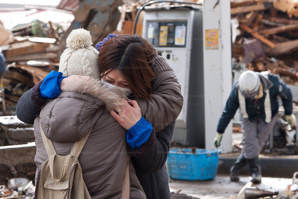 Two women are reunited for the first time since the tsunami struck on March 11th. Ofunato, Iwate, Japan. Thursday, March 17th 2011
